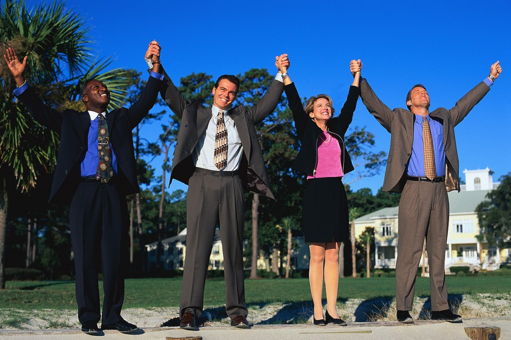 Business People Holding up Arms