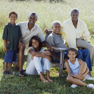 Smiling Family Posing in Field